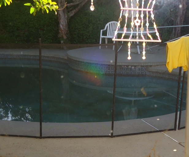Light and orbs and color near pool of the unconscious..by little Sony camera and me